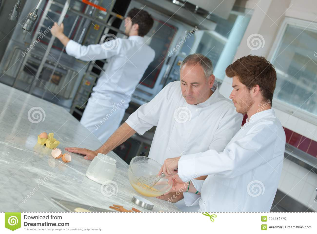 Head-chef rating plate one apprentices in kitchen