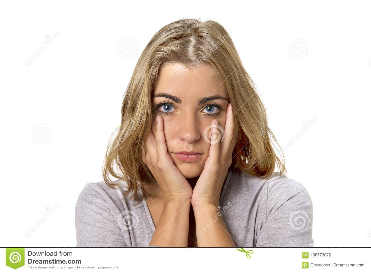 Head portrait of young beautiful and sweet blond girl with blue eyes looking sad and depressed, shy and worried in sadness emotion