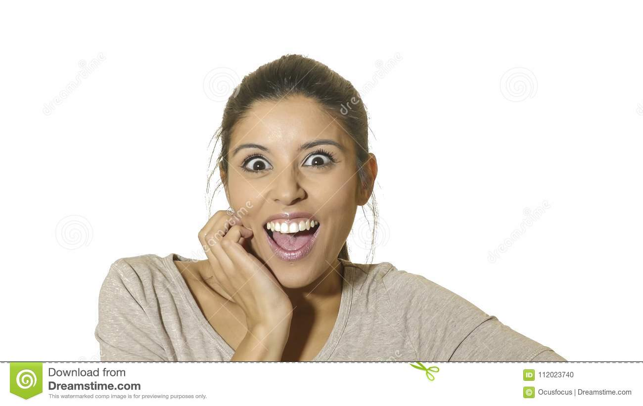 Head portrait of young crazy happy and excited hispanic woman 30s in surprise and astonish face expression with eyes wide open