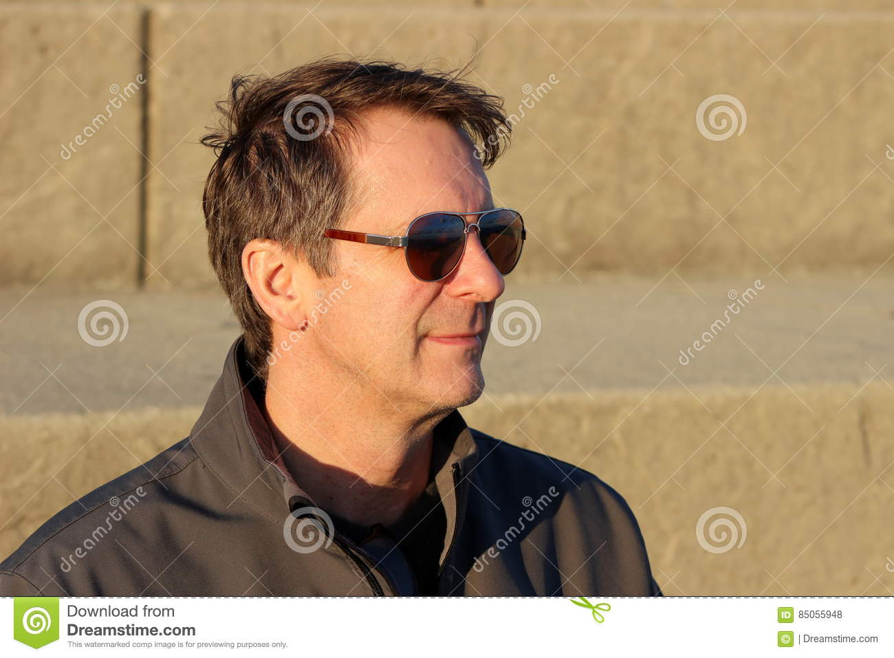 head and shoulders shot of middle aged man 3 4 view stock photo