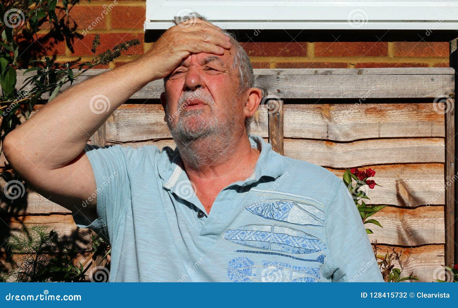 Headache or migraine. Man holding his head in pain.
