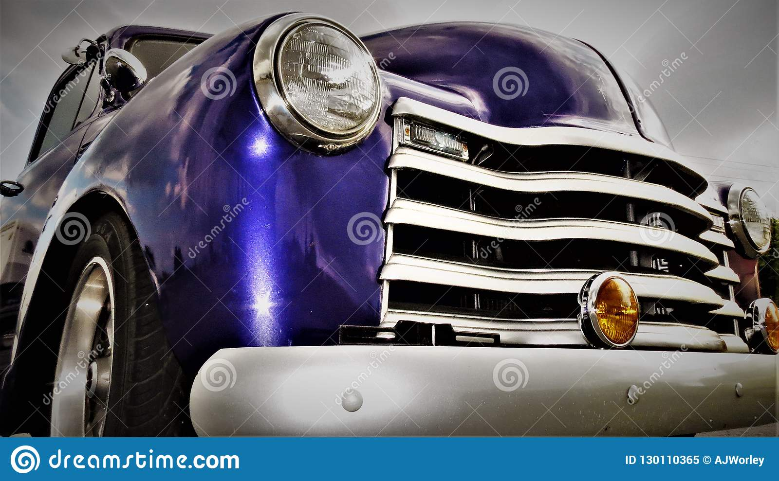 Headlight and Grill of a purple Antique American Pick Up Truck