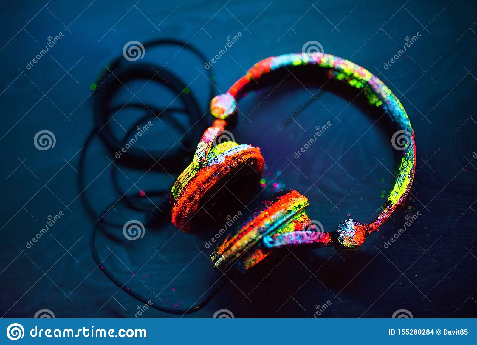 Headphones Painted In UV Powder. Concept. On The Body Of A