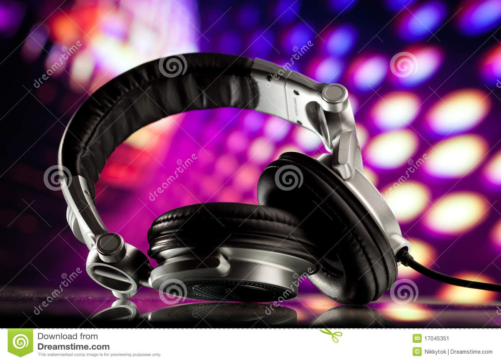 headphones on purple background stock image