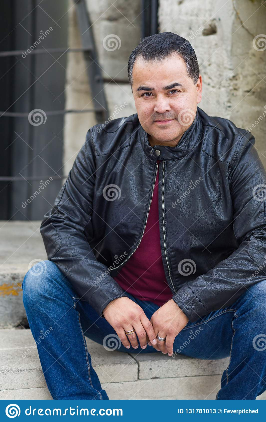 Portrait of Handsome Hispanic Man Wearing a Black Leather Jacket