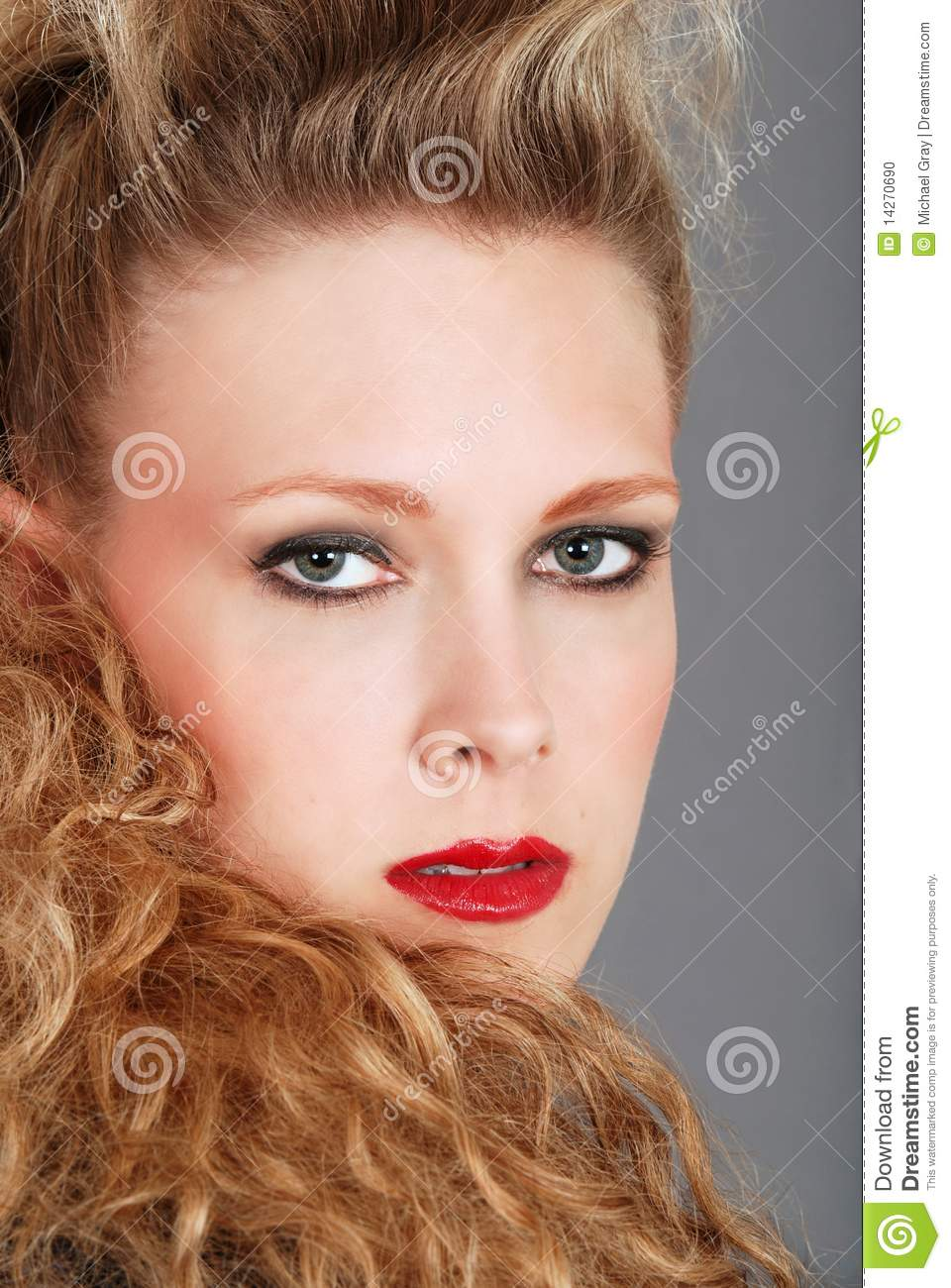 Headshot woman with curly hair