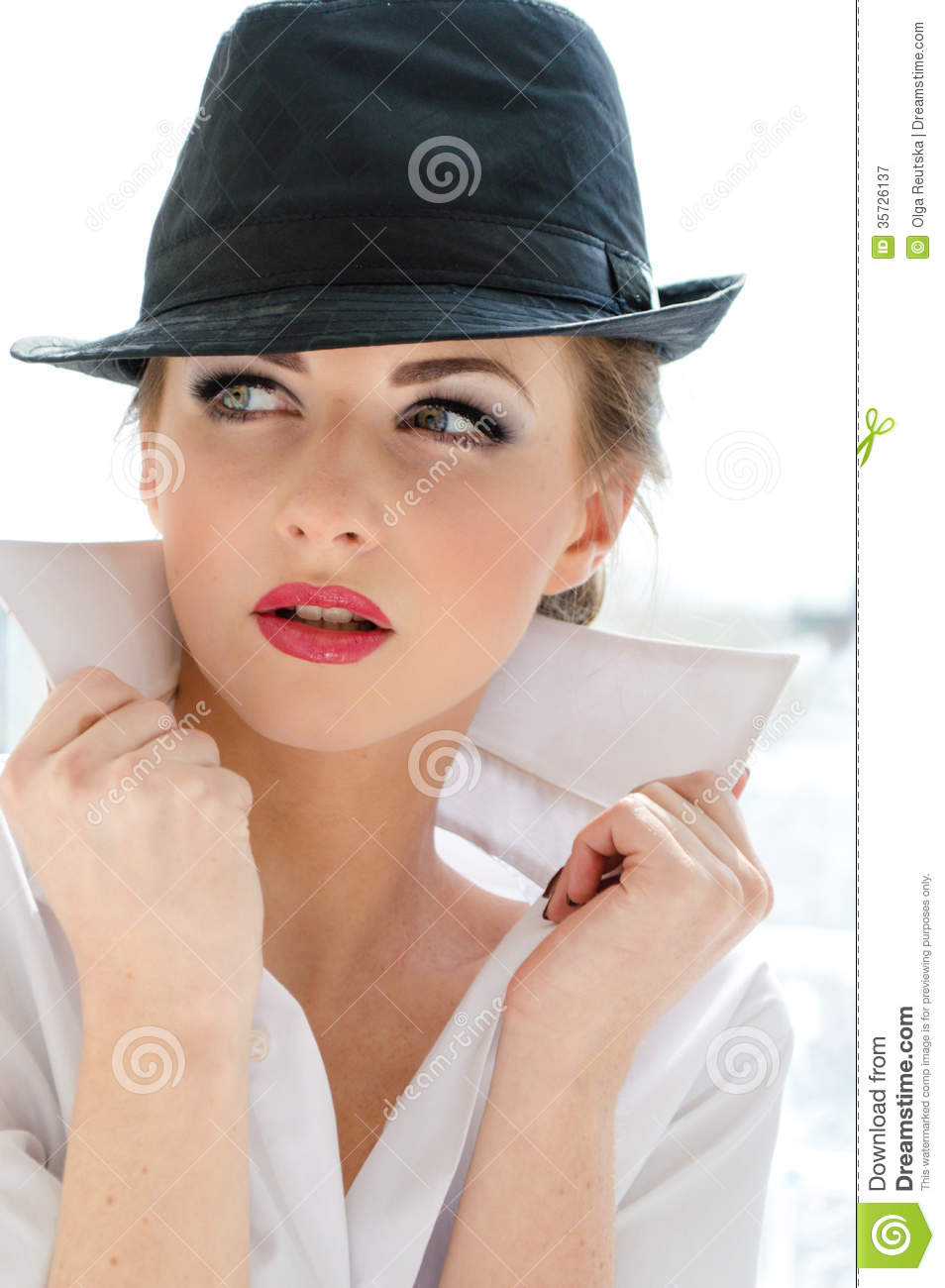 headshot-young-business-woman-wearing-man-s-shirt-hat-looking-bossy-stylish-office-white-background-35726137.jpg