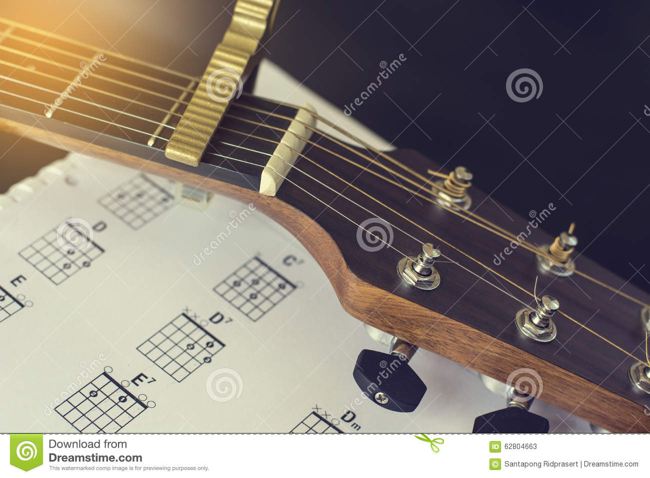 Headstock With Capo Of Acoustic Guitar And Basic Chord Stock Image