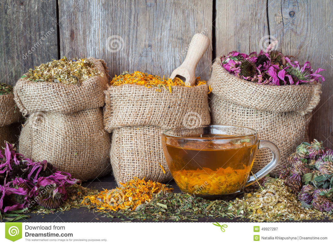 Healing herbs in hessian bags and healthy tea cup