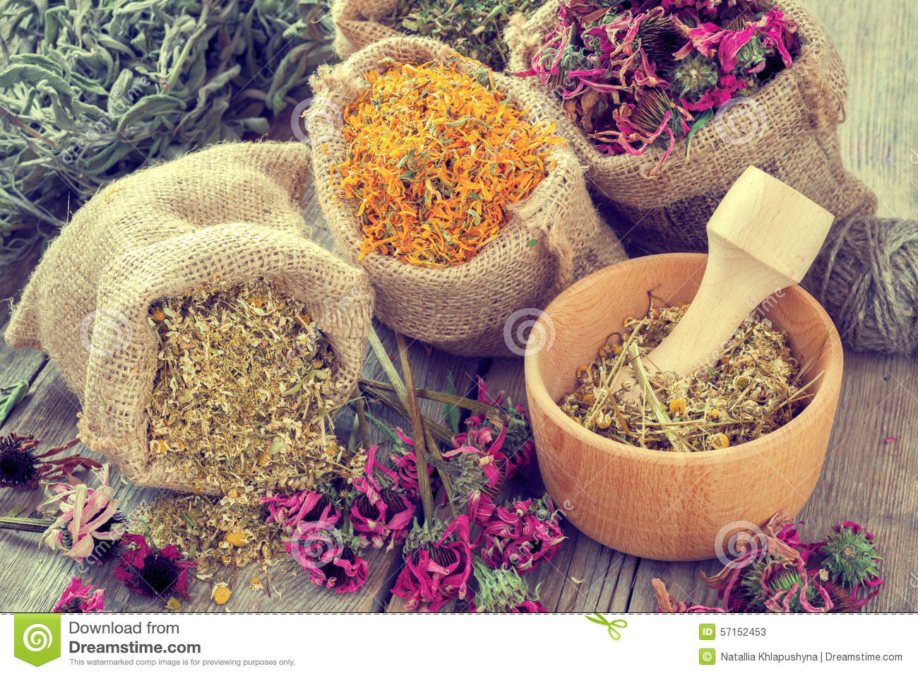 Healing herbs in hessian bags, mortar with chamomile