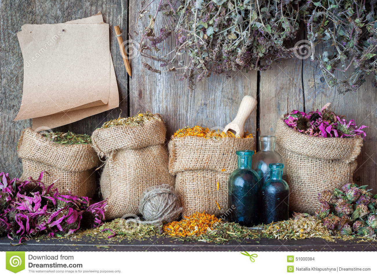 Healing herbs in hessian bags, paper sheet and bottles