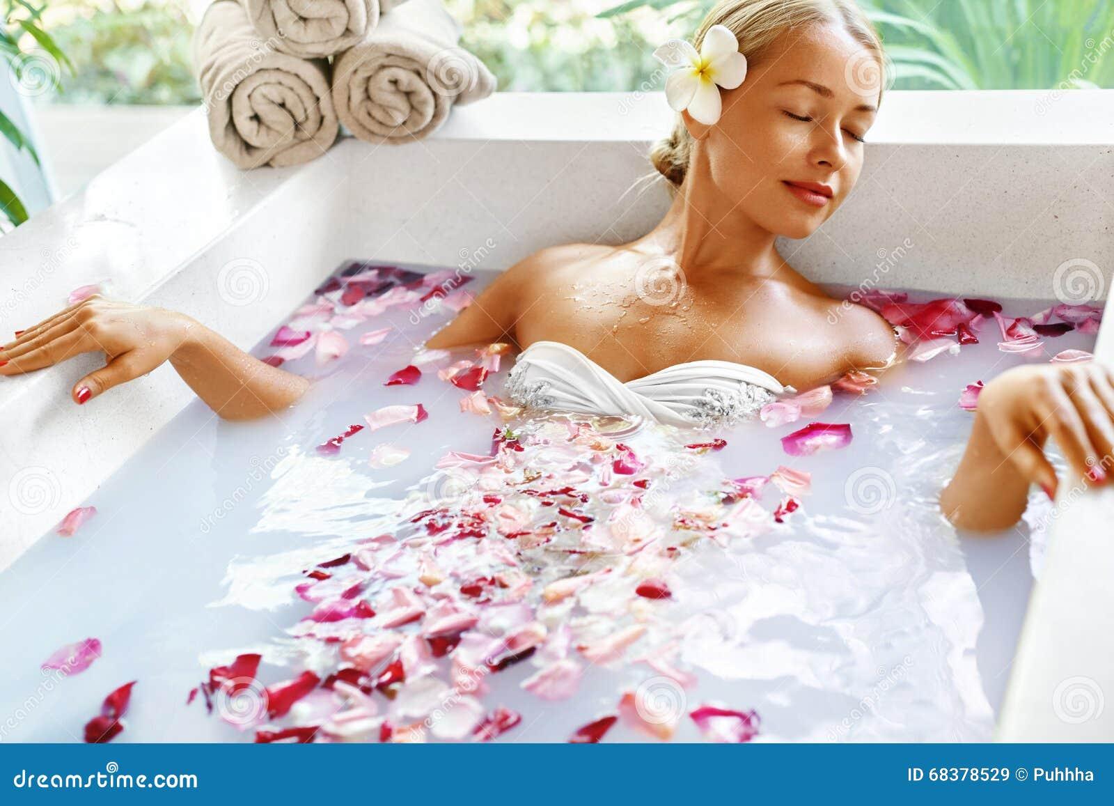 Health, Beauty. Woman Spa Body Care. Relaxing Flower Rose Bath
