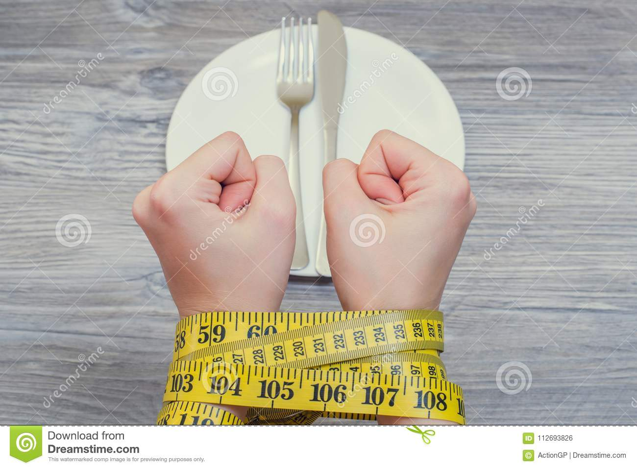 Health body care unhealthy eating dieting starving weight loss slimming. Concept of bad food habbits and unhealthy eating. Woman`