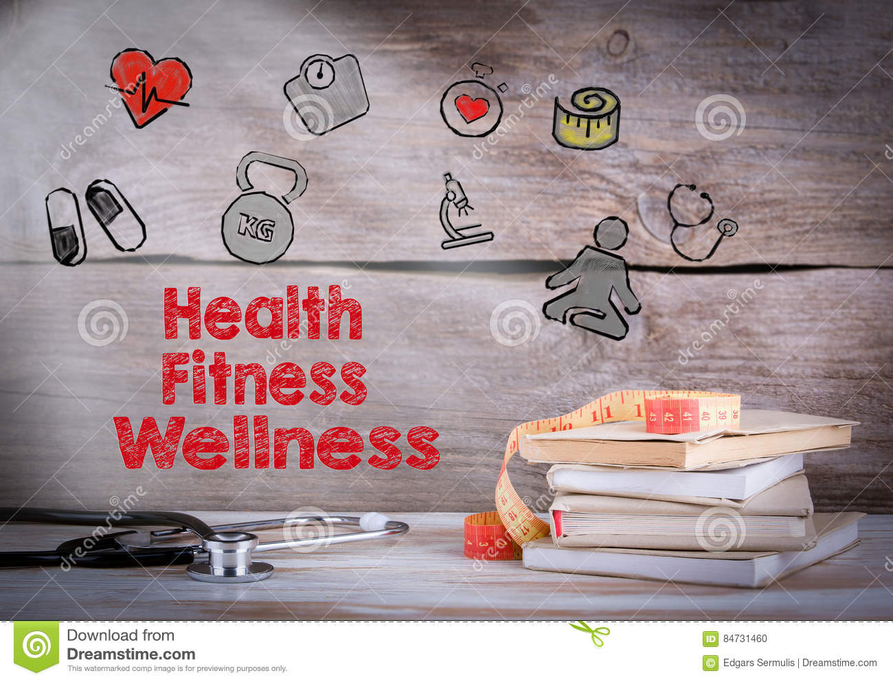 health  fitness  wellness  stack of books and a stethoscope on a wooden background stock photo