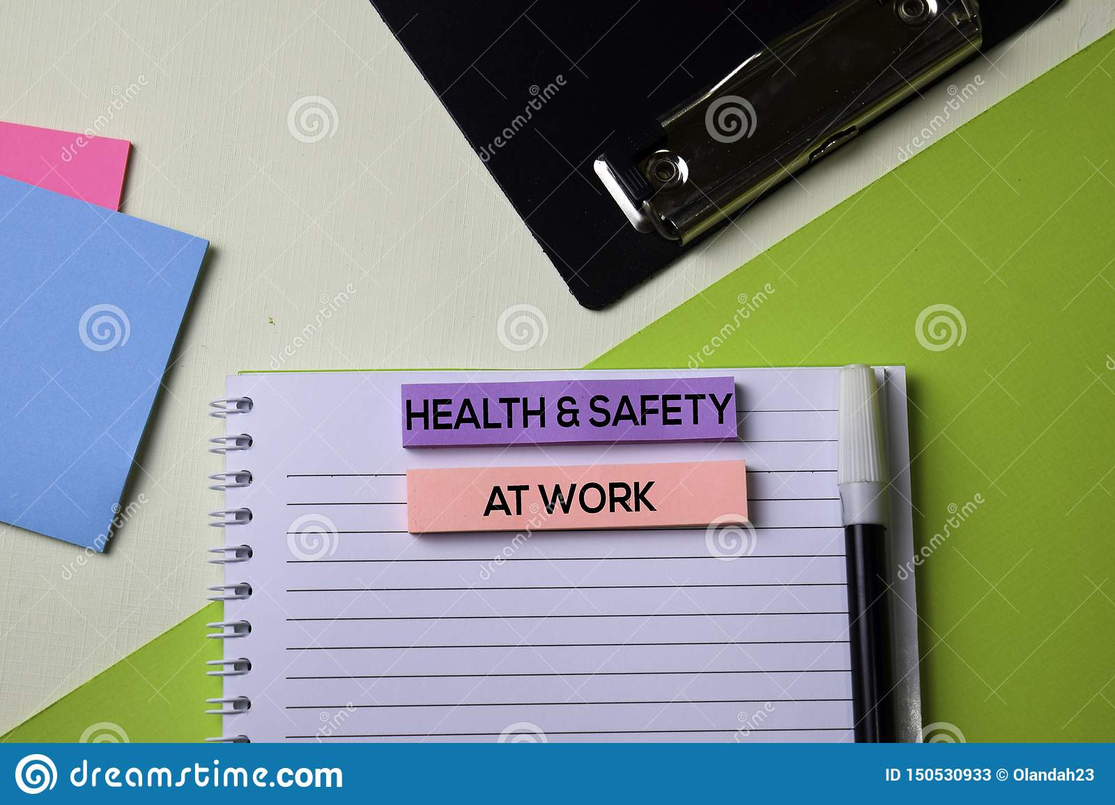 Health & Safety at Work text on top view office desk table of Business workplace and business objects