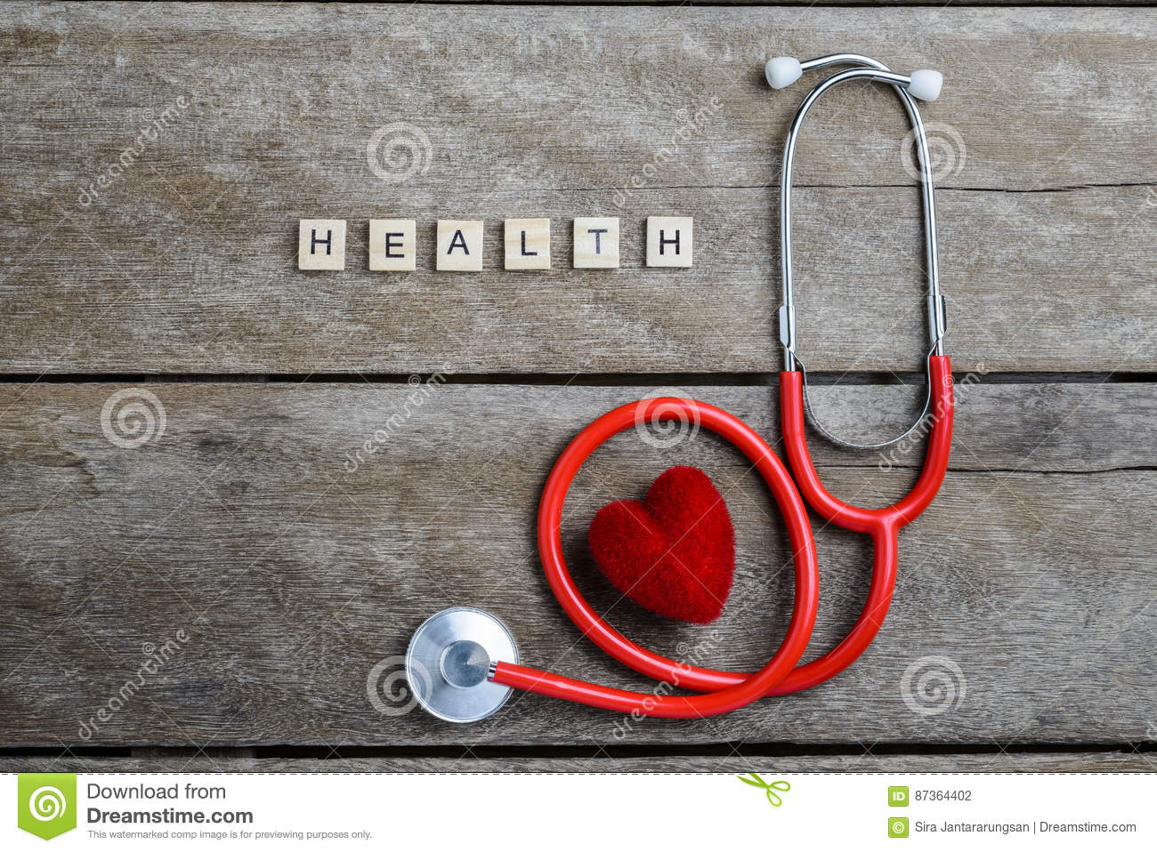 Health text word made with wood blocks and Red Heart,stethoscope on wooden table