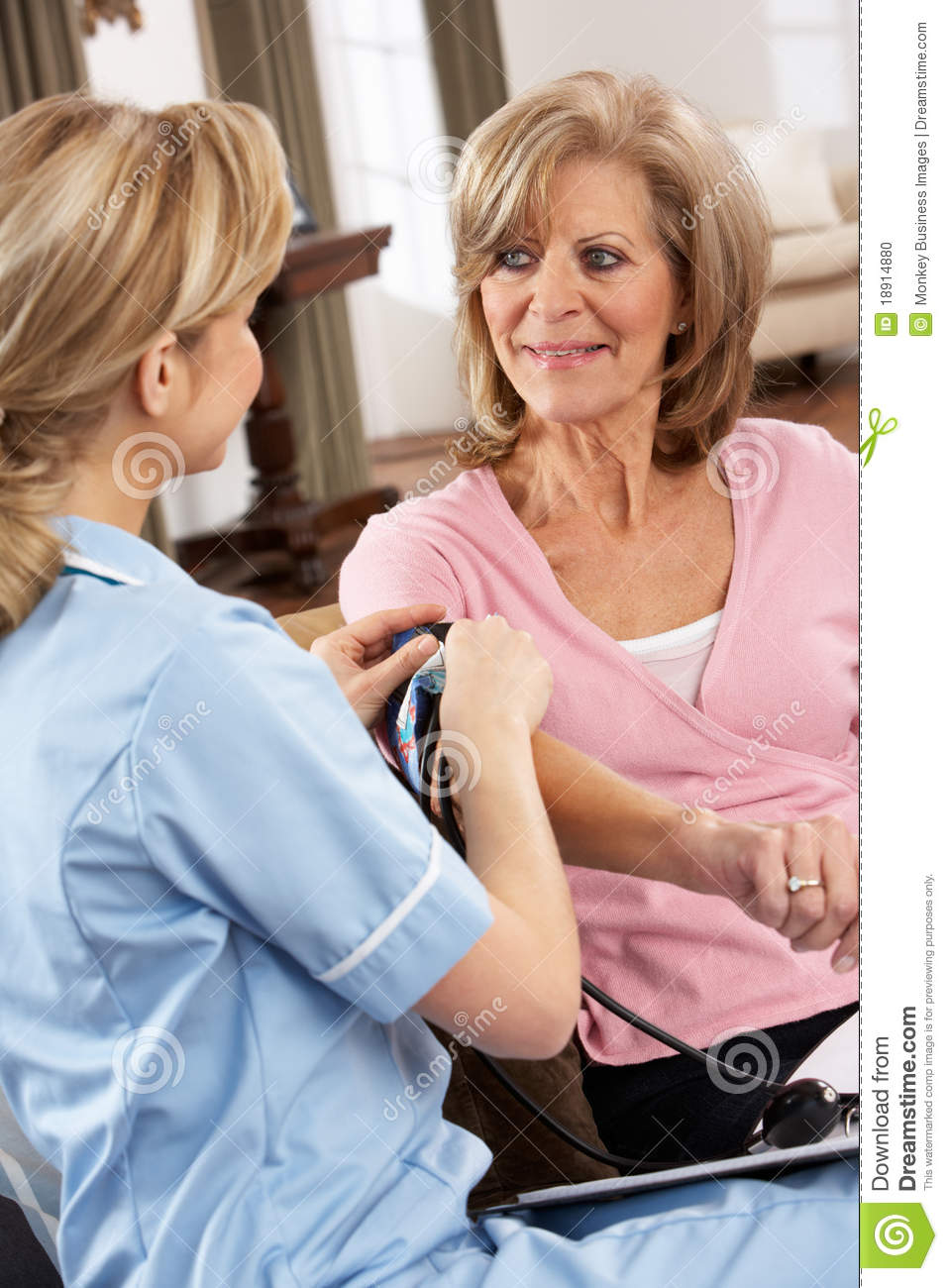 Health Visitor Taking Woman s Blood Pressure