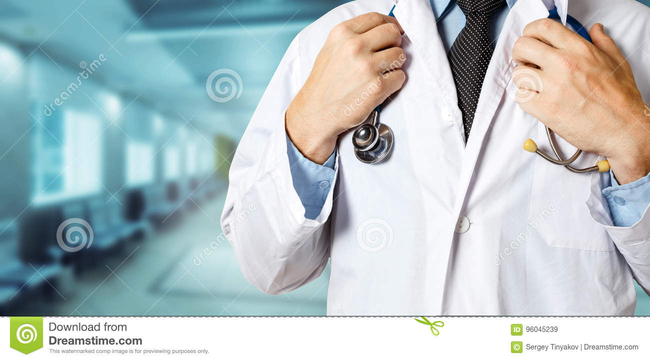 Healthcare and Medicine concept. Unrecognizable Male Doctor Holds Hands On Stethoscope