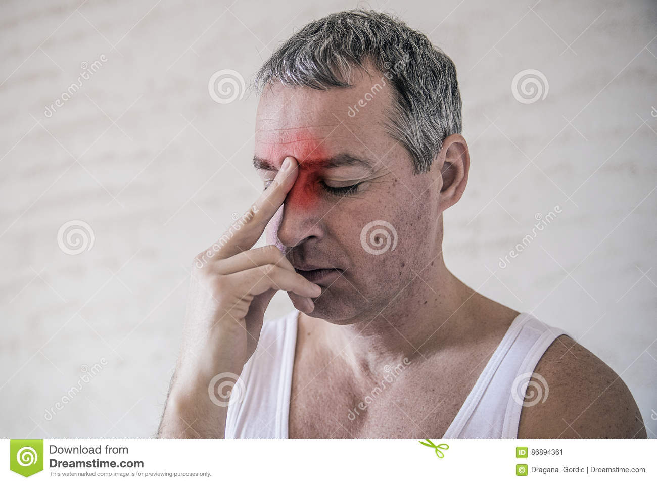 Healthcare, pain, stress, age and people concept -mature man suffering from headache at home