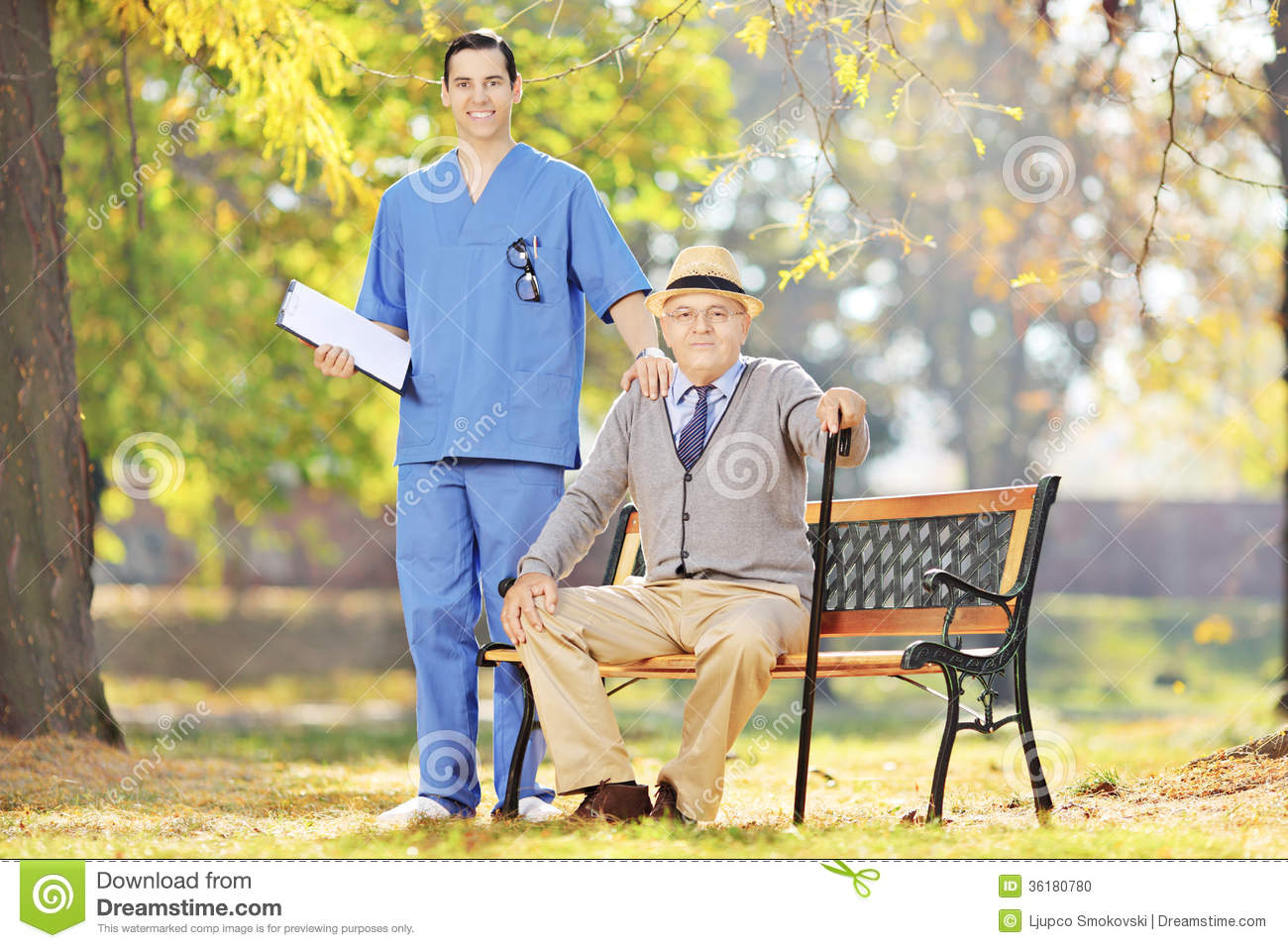 Healthcare Professional Standing Next To A Senior Man