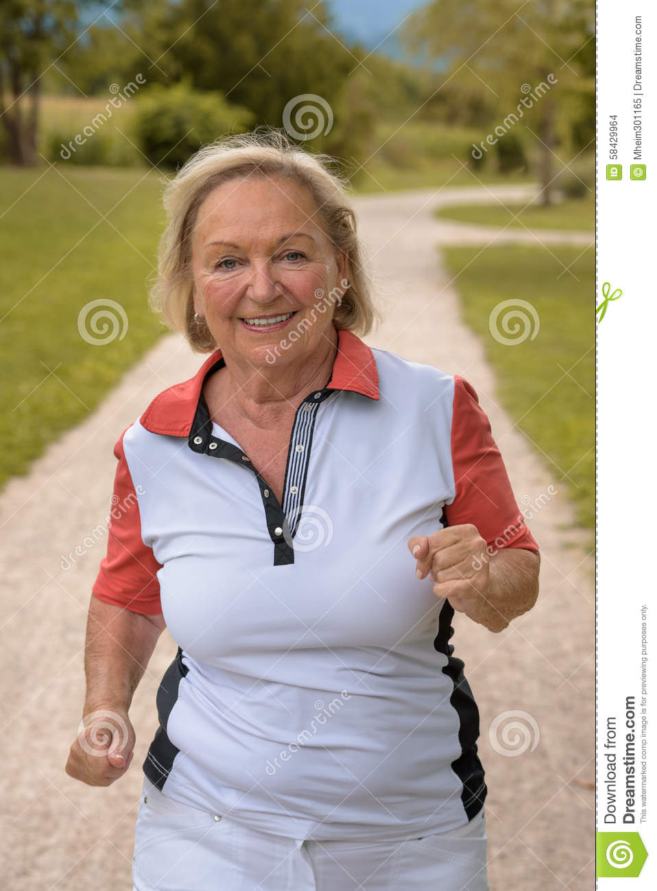 Healthy active elderly woman out jogging