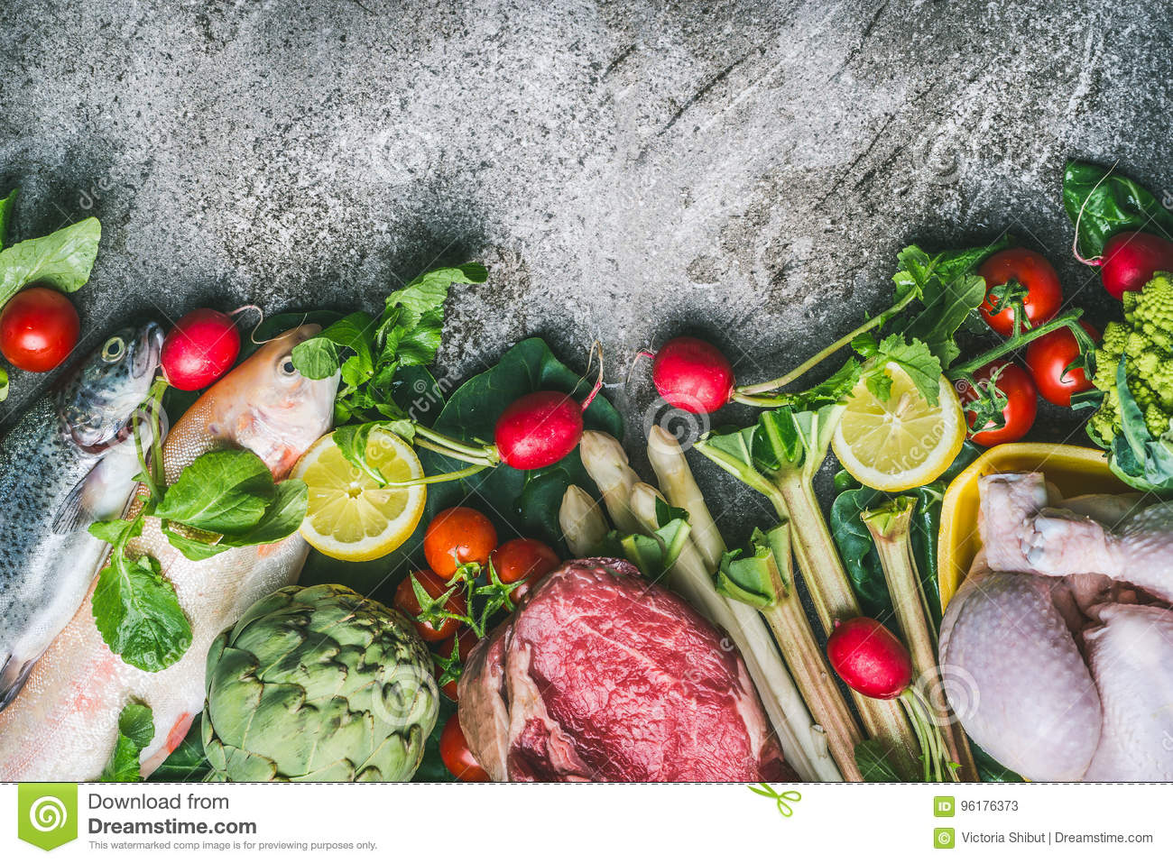 Healthy balanced eating and diet nutrition concept. Various organic foods ingredients: fish,meat,poultry,chicken,vegetables and gr