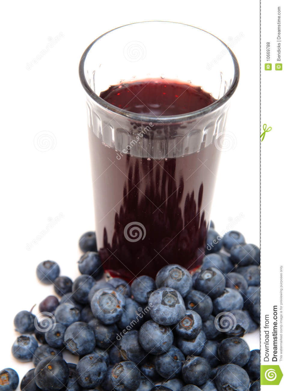 are a good source of antioxidants. a clear glass with berry juice ...