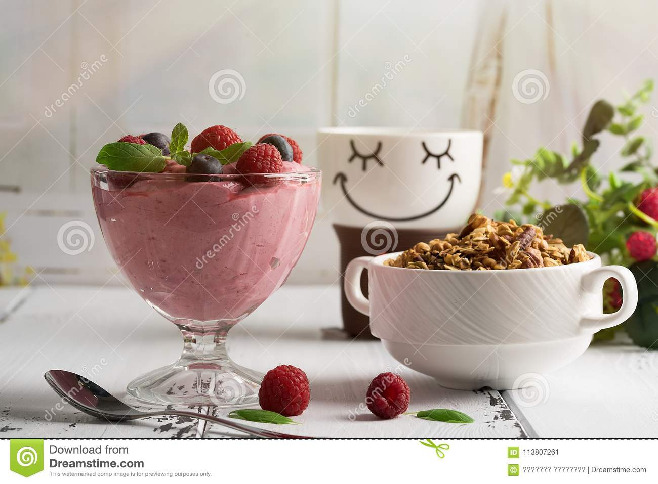 Healthy breakfast: Curd souffle with fresh blueberry, raspberries, granola and tea