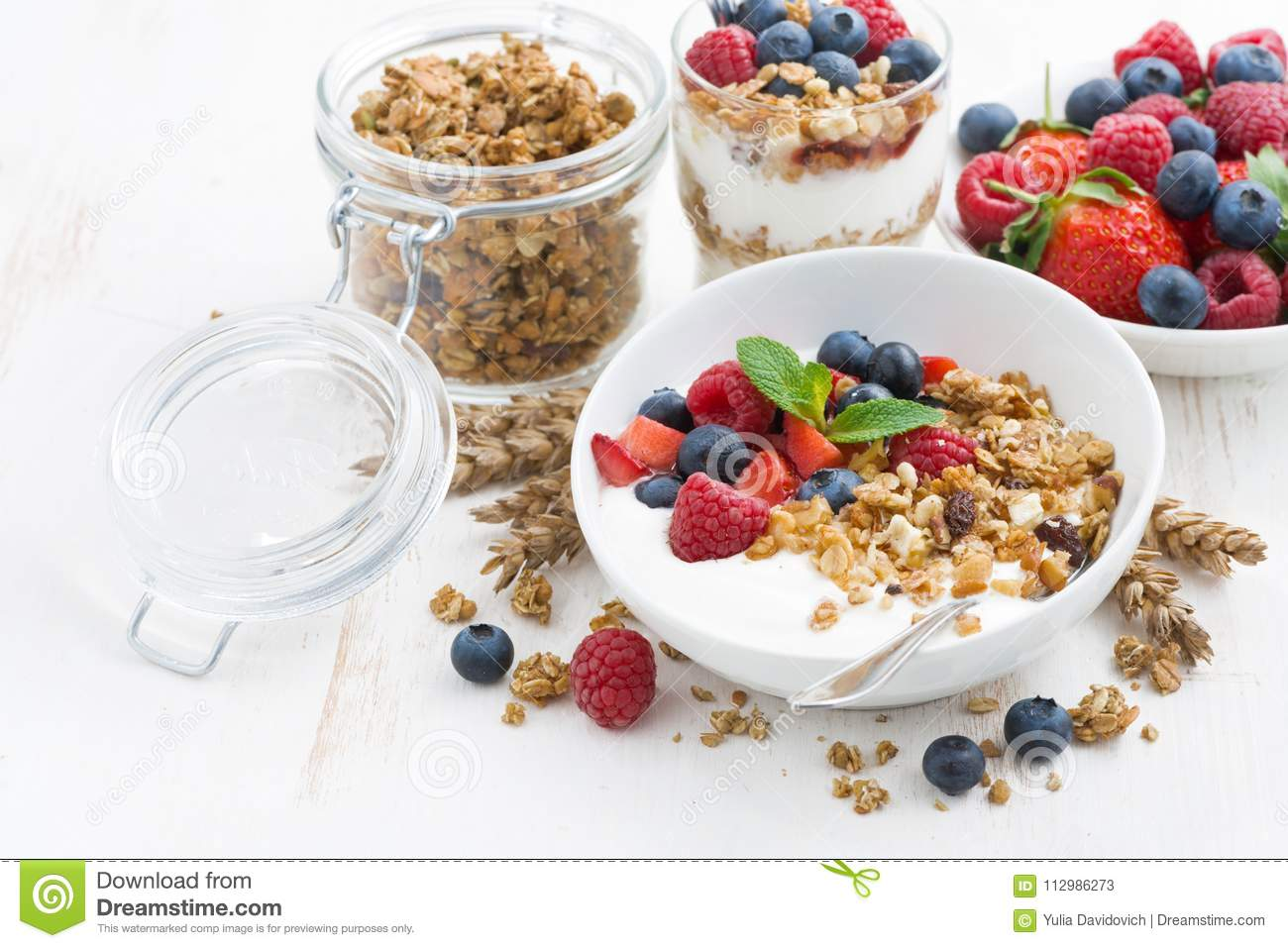 healthy breakfast with natural yogurt, muesli and berries