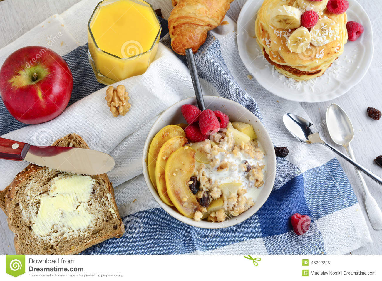 healthy breakfast table with variety of dishes stock photo