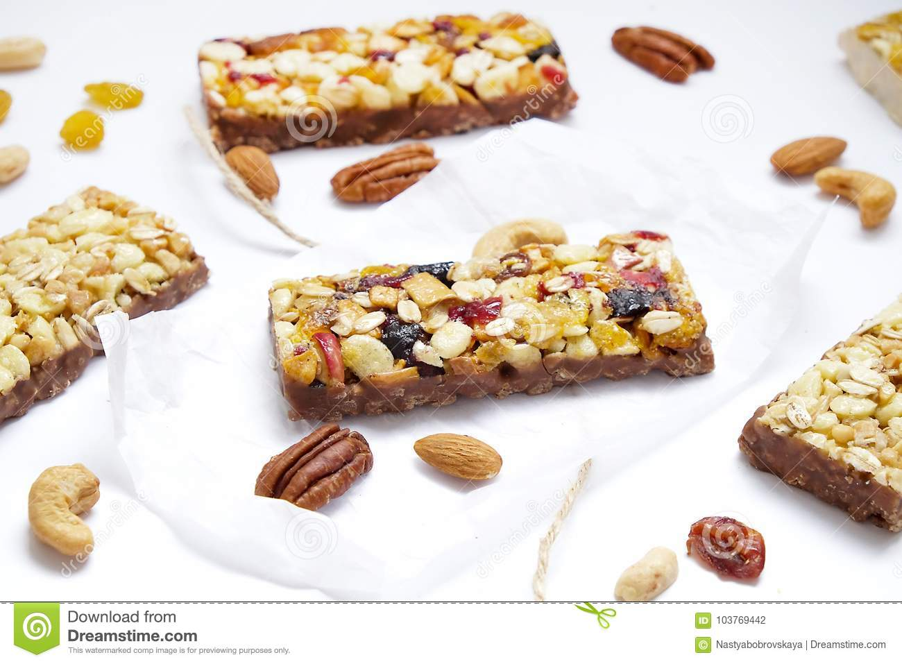 Healthy cereal granola bars with nuts and dry berries close up healthy breakfast on window sill homemade granola with nuts healthy granola bars with nuts seeds and dried fruits on white baking paper top view ccuart Image collections