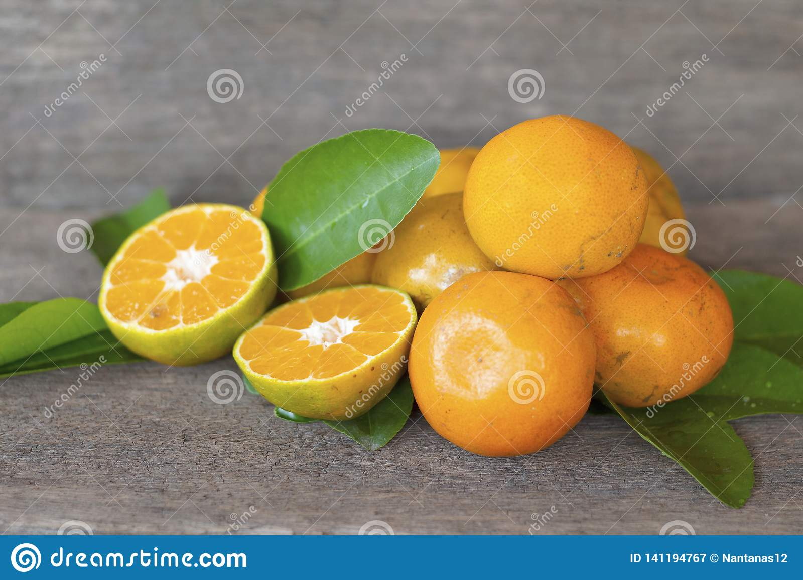 Healthy fruit oranges placed on old wooden floors