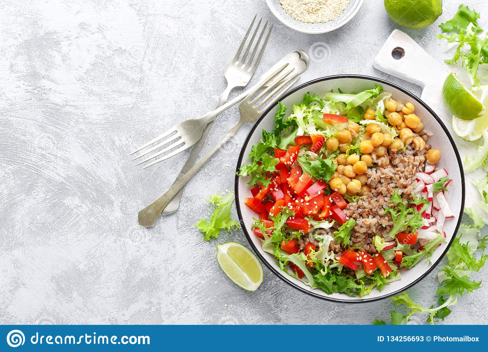 Healthy and delicious bowl with buckwheat and salad of chickpea, fresh pepper and lettuce leaves. Dietary balanced plant-based foo