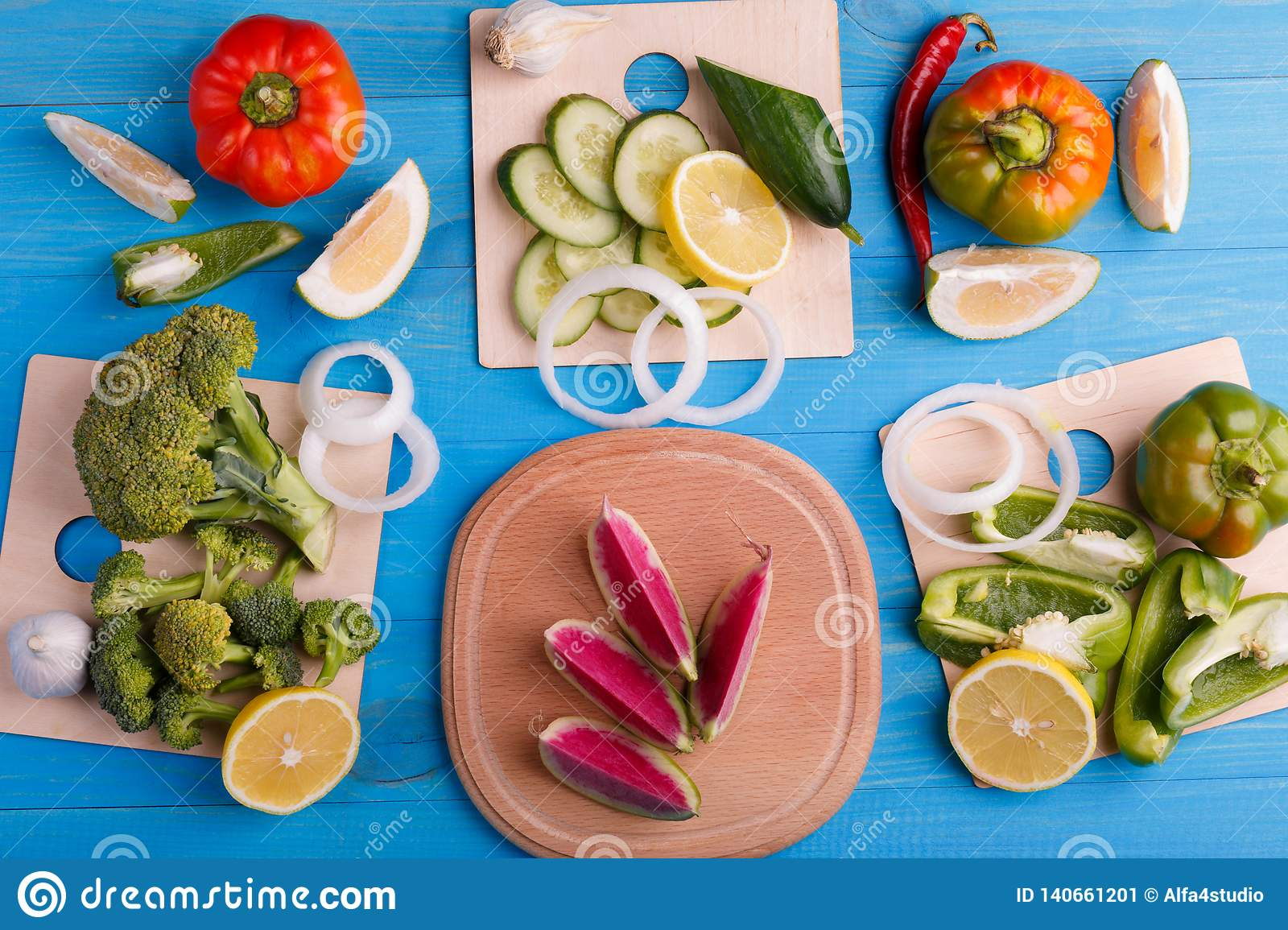Healthy eating background studio photography of different fruits and vegetables on old wooden table