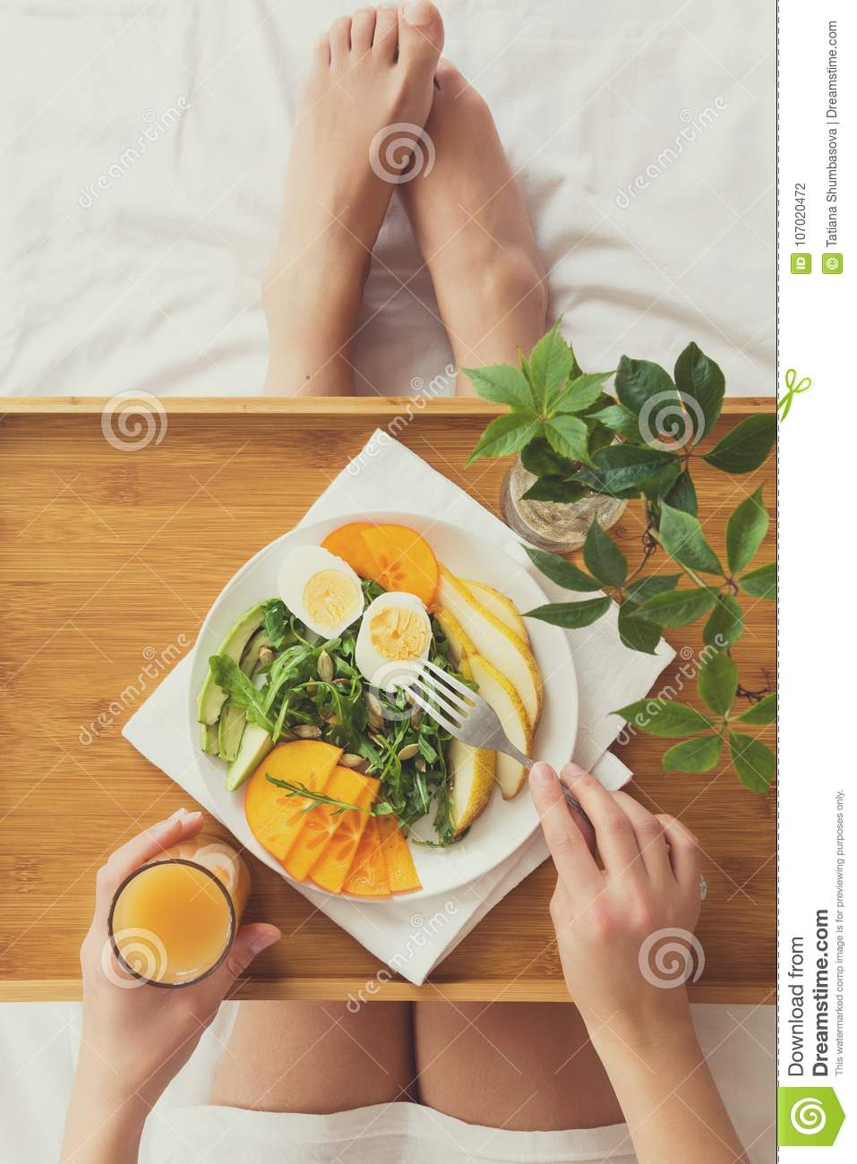 Healthy eating concept. Woman having breakfast in bed