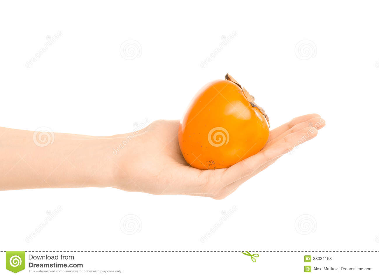 Healthy eating and diet Topic: Human hand holding a ripe persimmon isolated on a white background in the studio