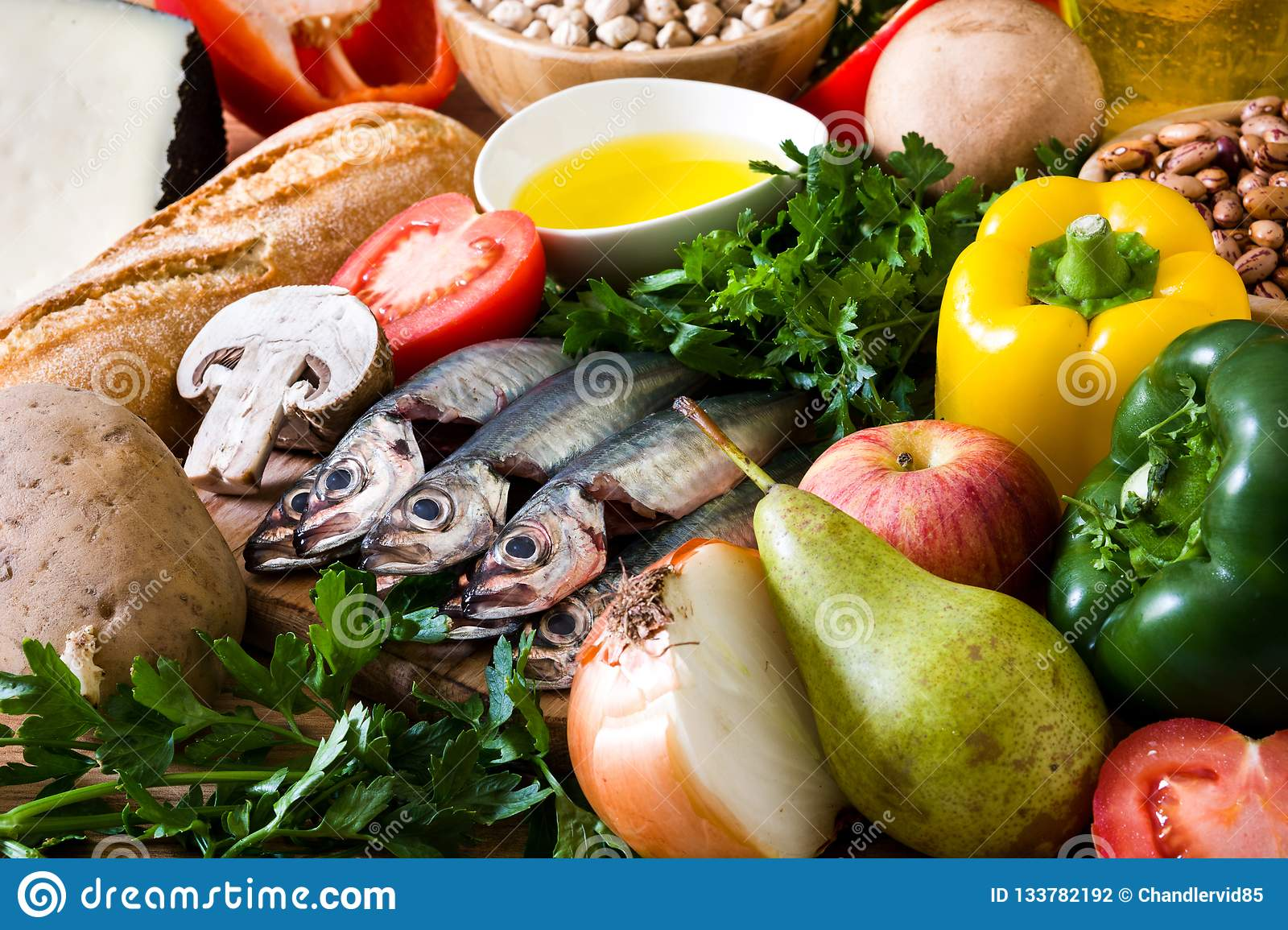 Healthy eating. Mediterranean diet. Fruit,vegetables, grain, nuts olive oil and fish