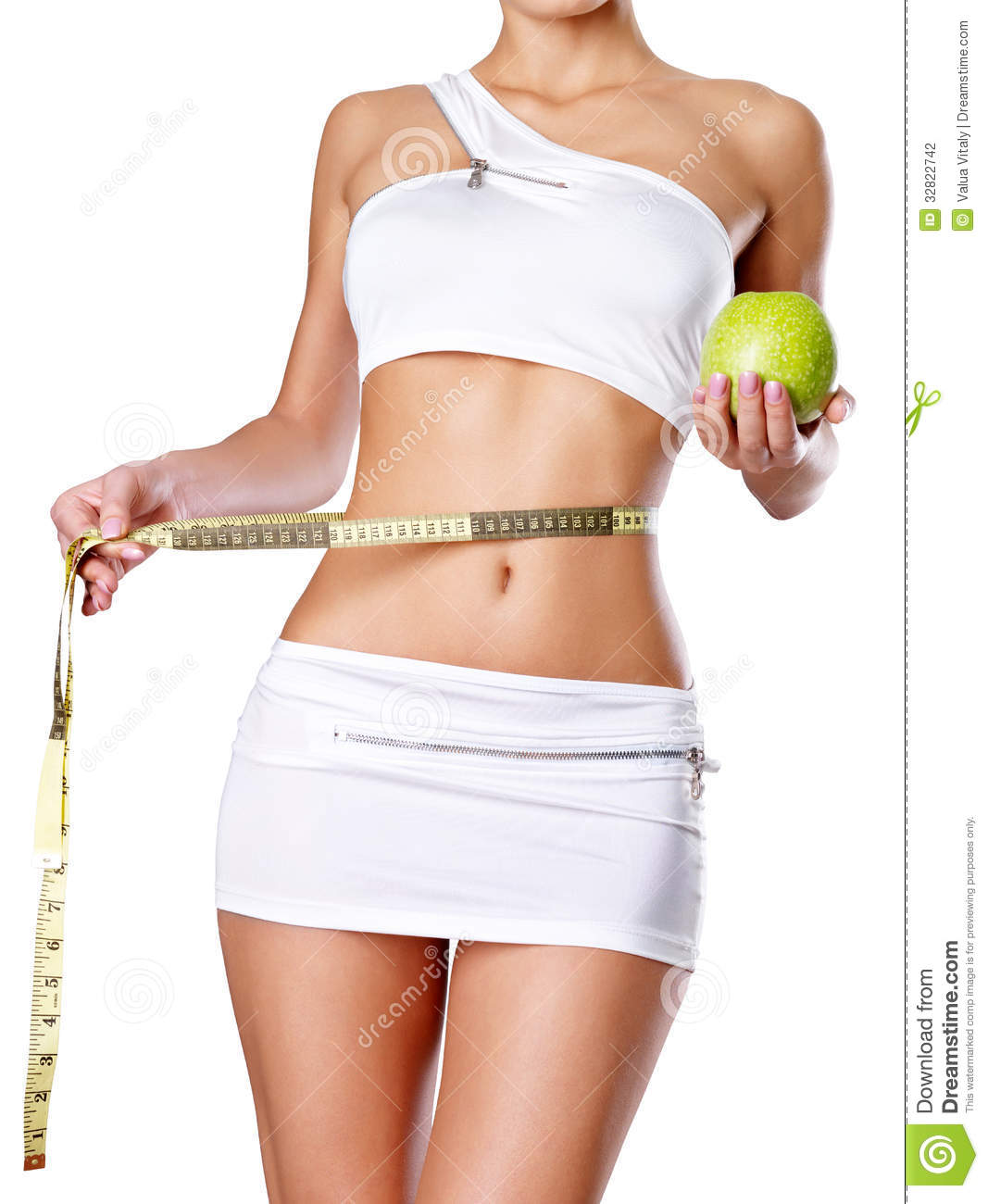 Healthy Female Body With Apple And Measuring Tape Stock Photo