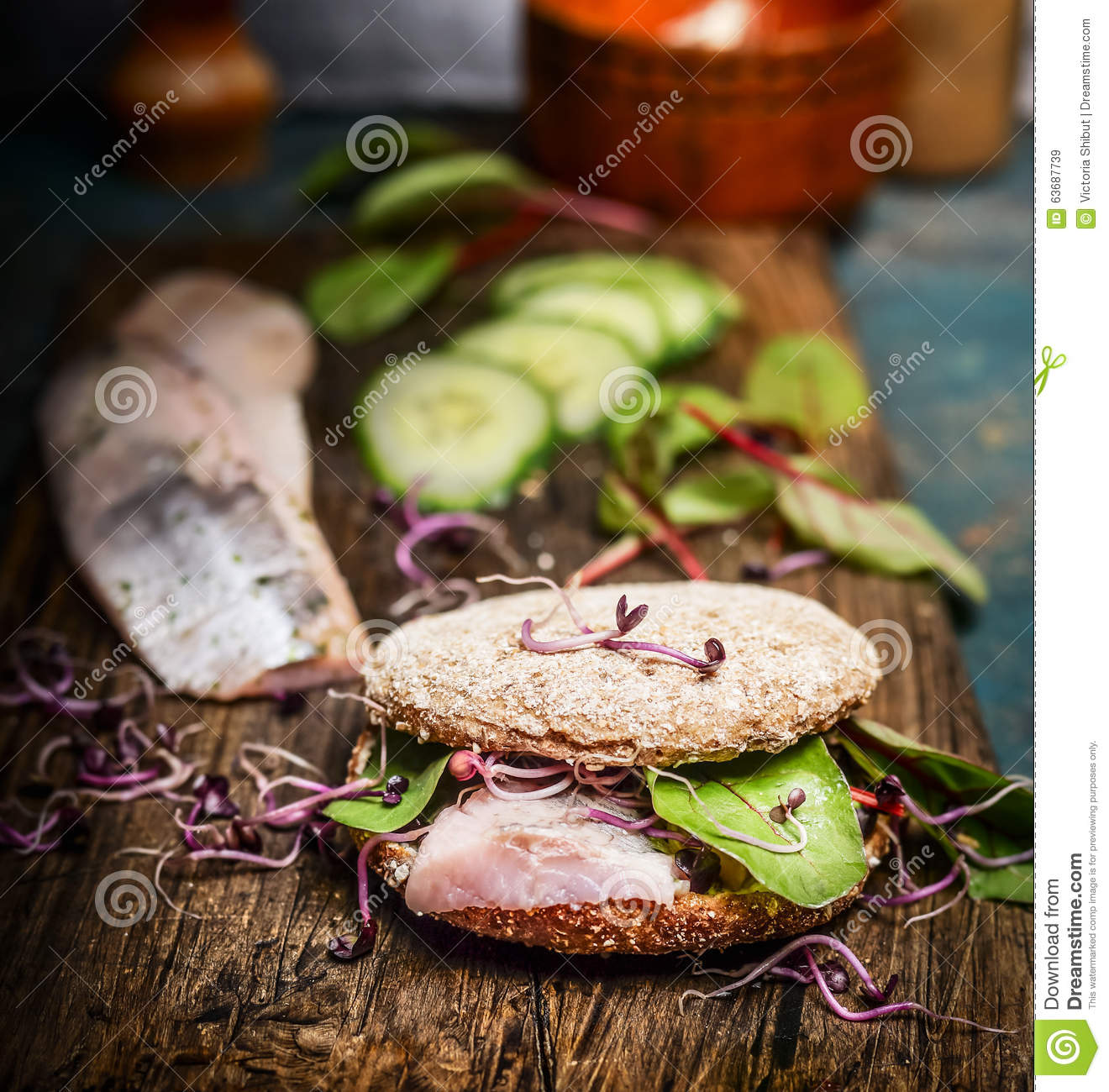 Download Healthy Fish Sandwich With Herring, Cucumber And Sprouts On Rustic Kitchen Table Stock Image - Image of board, bread: 63687739