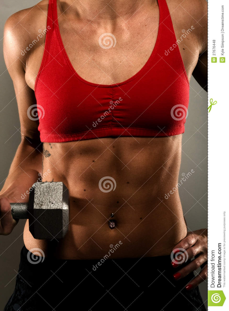 Healthy Fitness Woman Showing Her Muscles