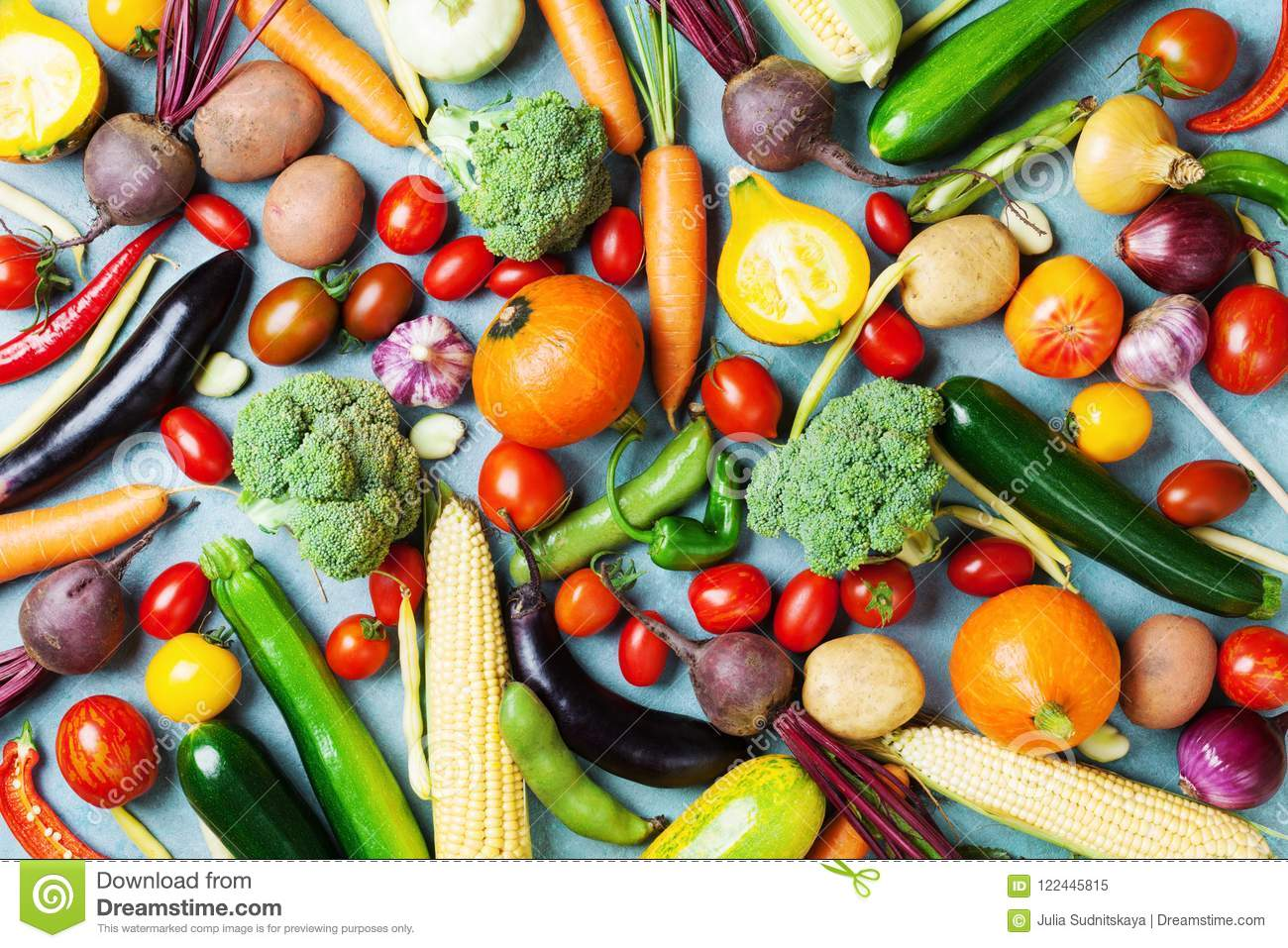 Healthy food background. Autumn vegetables and crop top view.