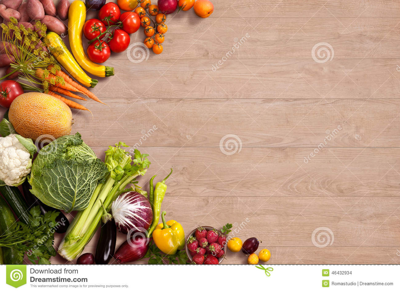 Studio photography of different fruits and vegetables on wooden table.