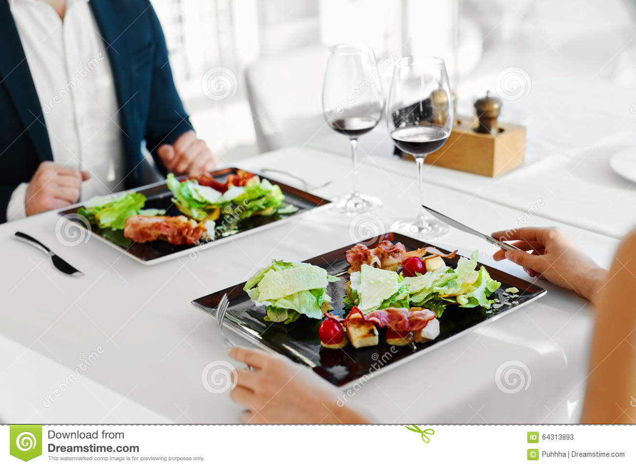 Healthy Food. Couple Eating Caesar Salad For Meal In ...