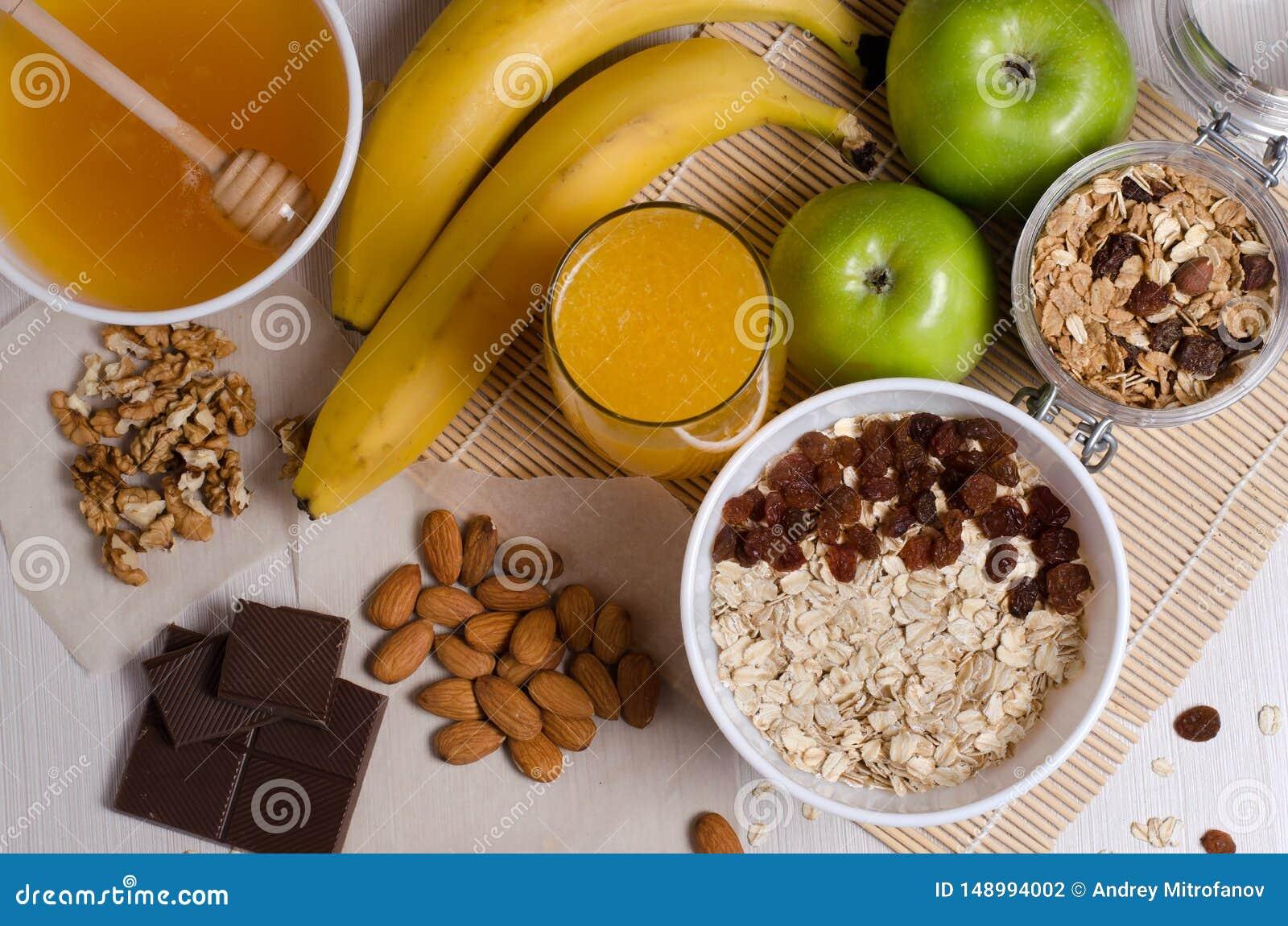 Healthy food. Fruit, homemade granola, nuts, chocolate, oatmeal