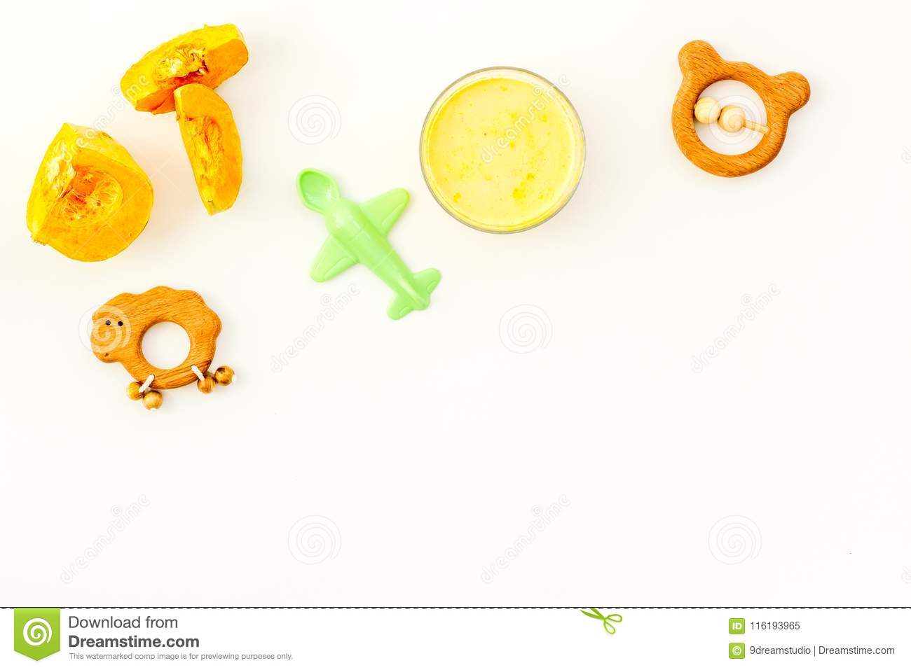 Healthy Food For Little Baby  Puree With Pumpkin Near Toys On White