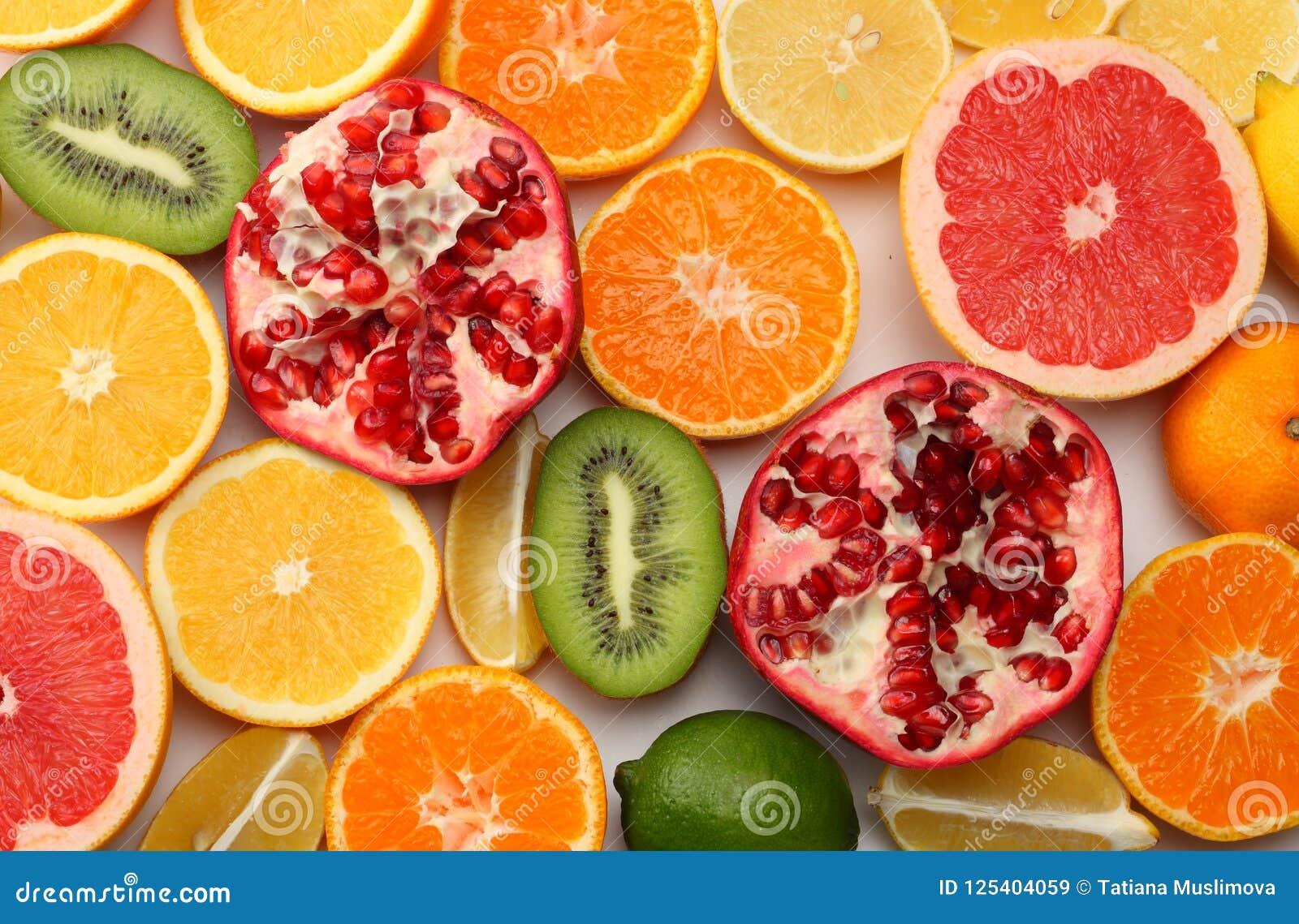 healthy food. mix sliced lemon, green lime, orange, mandarin, kiwi fruit and grapefruit isolated on white background. top view