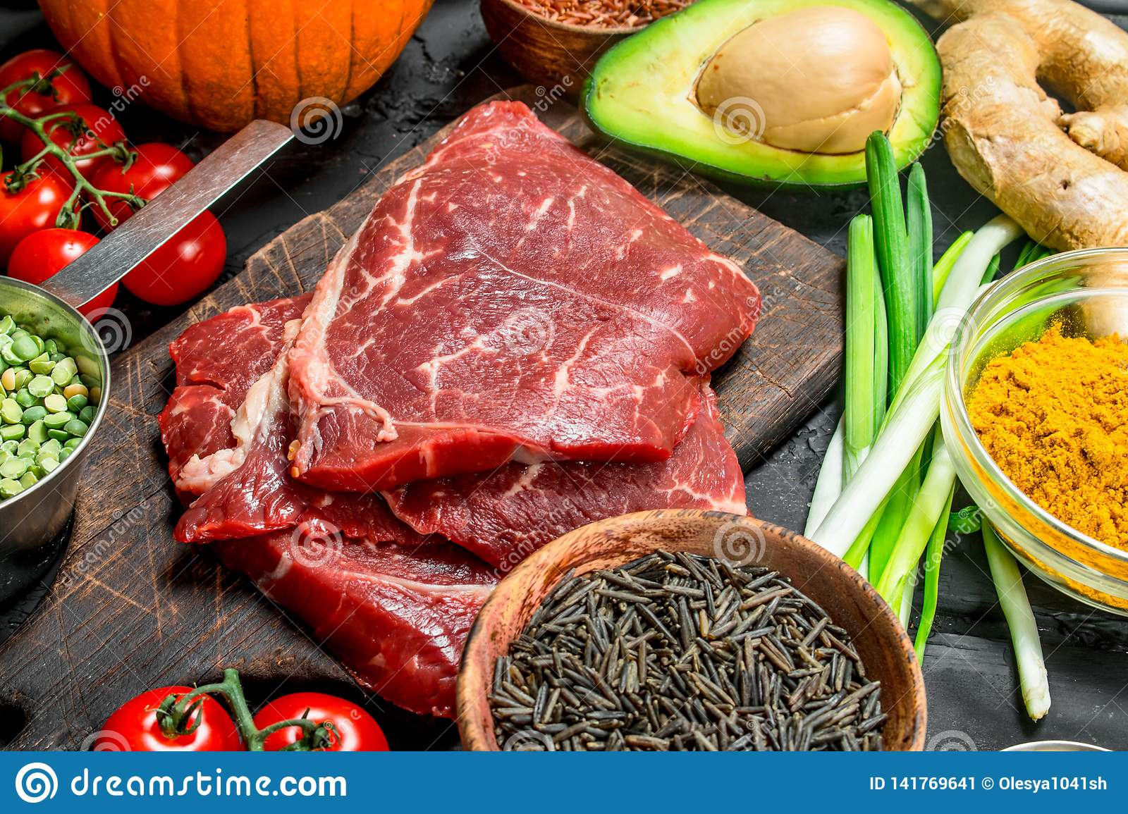 Healthy food. Organic food assortment with raw beef steaks