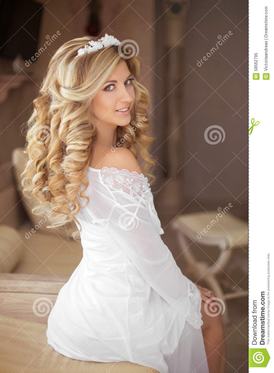 healthy hair. beautiful smiling girl bride with long blonde curl