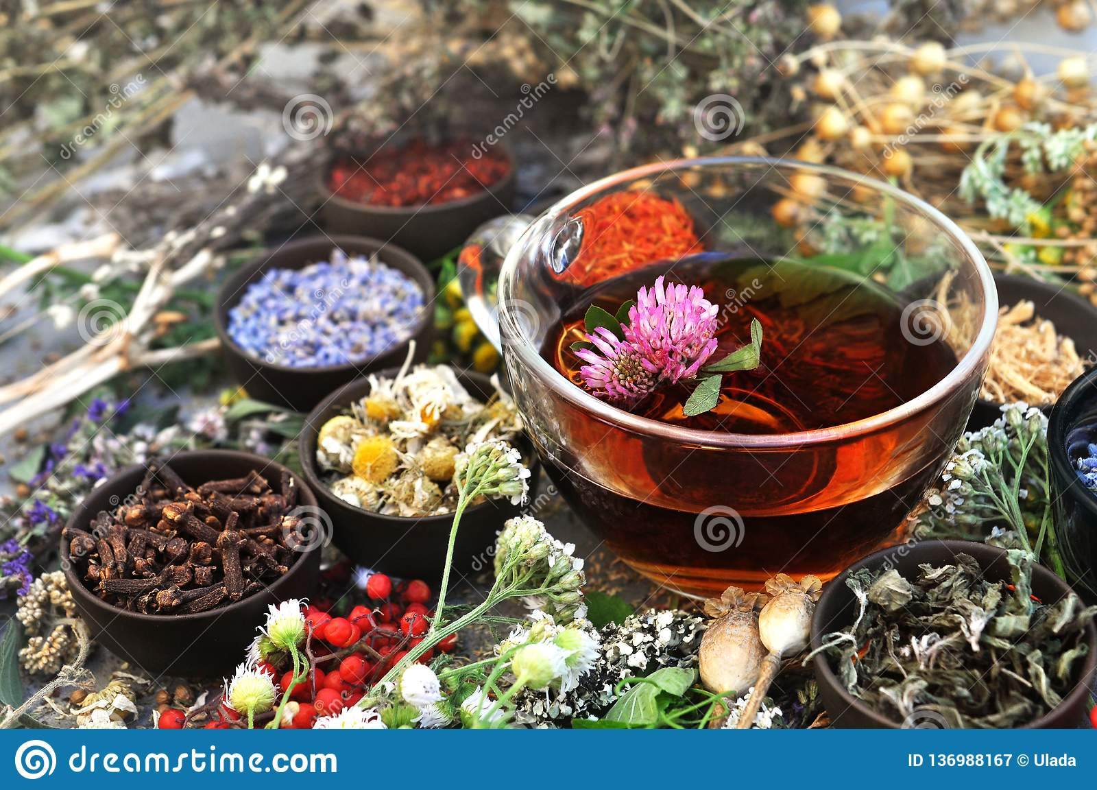 Healthy herbal tea on medicinal flowers and herbs background