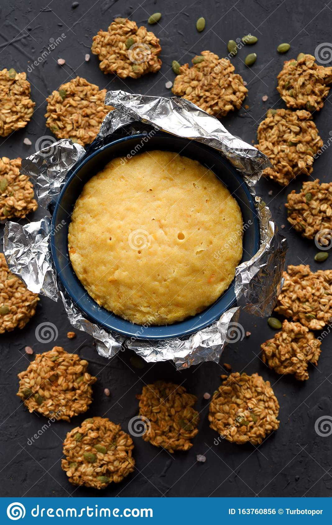 Healthy Homemade Pumpking Dishes Pumpkin Steam Pudding In Baking Foil And Pumpking Oatmeal Vegan Cookies On Black Background Stock Photo Image Of Creamy Culture 163760856